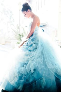 Gorgeous blue wedding dress for the daring bride! - I'm just not to sure about the way they did the gathers or those flower looking things...?