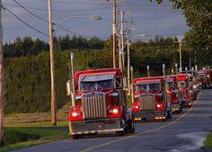 Rolling red Kenworth semi trucks