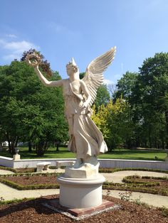 I took pictures of this statue at the Wilanow Palace in Warsaw, October, 2013. Stunning Palace and gardens.