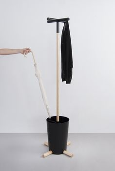 Cool idea provided you find such an interesting bucket: drill it, insert rods, pour cement to cover the rods and provide stability by weight, also plant the vertical pole in the cement, 3d-print the upper hooks (make it architectural and as complicated/organic as the 3d-printer allows)