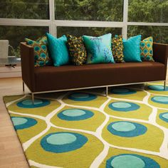 Peacock rug, pillows living room decor