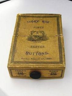 ButtonArtMuseum.com - Rare Original Box of Antique Ivory Rim Cloth Center Buttons by ava