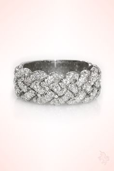 The perfect anniversary diamond band , Woven diamond ring in white gold.  The woven diamond ring is custom made from 14K or 18K specifically in your wanted gold color and feathers 0.80 carat G, VS white diamonds , comfort comfy fit from the inside and solid back. Fully pave set. Rock this baby out for daily dopamine boost