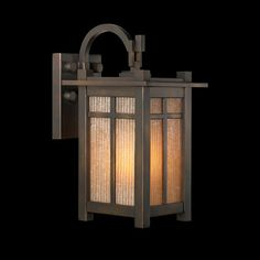 Nice contrast in textures between the ridged glass and the smooth bronze finish for this Craftsman style small exterior wall lantern.CALL TOLL-FREE 1-866-339-5060 FOR BEST PRICE. Craftsman/Mission Capistrano Small Outdoor Wall Lantern - Fine Art Lamps 402181