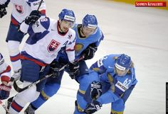 Slovakia's Miroslav Satan (L) tries to break through from Kazakhstan's Dmitri Dudarev behind Vadim Krasnoslobodtsev during Group H game Slovakia vs Kazakhstan of the 2012 IIHF Ice Hockey World Championships in Helsinki, Finland, on May 9th