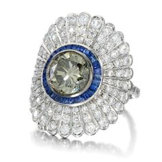 The rare carat Fancy Grey diamond in this Jessica McCormack Daisy ring is set off by a surround of blue sapphires (POA). Most Expensive Ring, Jewelry For Her, Fine Jewelry, Jewelry Art, Jewelry Design, Yellow Diamond Rings, Daisy Ring, Fancy, Colored Diamonds