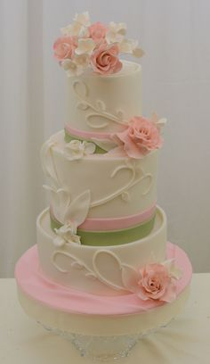 Round Wedding Cakes - 4,6, and 8 wrapped in fondant with fondant and gumpaste accents. Vine work attached with piping gel.