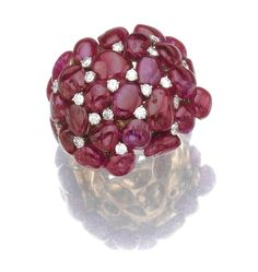 RUBY AND DIAMOND RING, MICHELE DELLA VALLE Of bombé cluster design set with cabochon rubies, highlighted with brilliant-cut diamonds, mounted in gold,  Signed Michele della Valle and numbered, Italian assay marks.