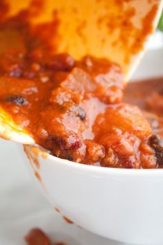 Slow Cooked Sweet Potato Chili--First snow day of the year and I put this in the crock pot before I went to work this morning. I just got home, and my house smells like heaven and this chili tasted DIVINE!! I followed the recipe to the t and it came out perfect. I, however, like spicy food, and didn't find this to have much kick. So I went ahead and added some more chile powder, let it simmer a bit longer, and it is now, PERFECT!!  Made some cornbread to go with it and I couldn't be happier.   (:  Try it, you'll be glad you did!