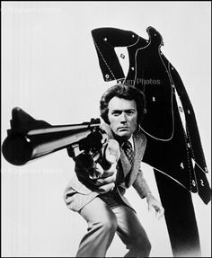 "Philippe Halsman  USA. The American actor and filmmaker Clint EASTWOOD, the lead actor pointing a gun in Ted POST's movie ""Magnum Force"". 1973."