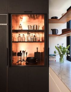 Talk about a bar! Hidden and streamlined dry bar that can be tucked away to clear visual clutter.