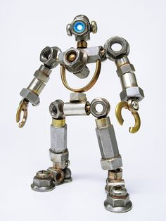 Good use for all those stray nuts and bolts. Welding Art Projects, Welding Crafts, Metal Art Projects, Metal Crafts, Metal Robot, Metal Toys, Arte Robot, Mechanical Art, Metal Art Sculpture