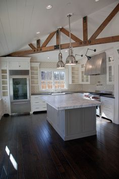 My floor color with white cabinetry and gray island?  Urban farmhouse near San Francisco. Architect Robert Baumann.
