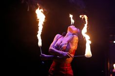 LIMBO's sword swallower and vintage beauty, Heather Holliday, eats fire.