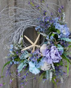Spring Wreath, Beach Wreath, Easter Wreath, Summer Wreath, Seashell Wreath, Cottage Wreath, Coastal Wreath, Nautical Decor, Floral Wreath  Nantucket Beach Cottage Wreath. An abundant gathering of starfish, sand dollars and clam shells are accented by lush Hydrangeas, Peonies, clusters of Queen Annes Lace, wildflowers and meadow grass in gorgeous Summer beach hues of soft aqua, light blue, lilac and ivory set upon a whitewashed twig base. Very full and lavish, this wreath is certain to add a…