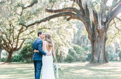 Stylish bride and groom's CHARLESTON WEDDING photos under the Giant Live Oak Tree and Spanish Moss at The Legare Waring House » Aaron and Jillian Photography