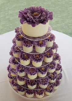 Great Idea-but want a different color of purple Purple wedding cupcake tower.this is what I'm going to do at my wedding before my cake comes out. Except the flowers on top of the cupcakes will be the flowers in my bouquet. Flower Cupcakes, Cupcake Cakes, Mini Cakes, Mocha Cupcakes, Strawberry Cupcakes, Cake Flowers, Easter Cupcakes, Velvet Cupcakes, Fairy Cakes
