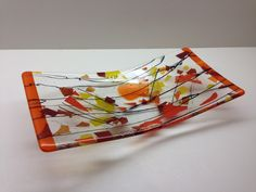 """Crossing Paths. Fused glass in Autumn colors. 12"""". By Bryan Burgin"""