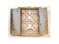 Moroccan shuttered window, painted wood and wrought iron, antique early twentieth century. This window is in its own juice, she had the custom of the time. Window Screens, Window Shutters, Moroccan Garden, Iron Windows, Wrought Iron Gates, Door Knockers, Painting On Wood, Heavy Metal, Painted Wood