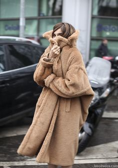 Trade your standard black coat for a faux fur brown one | @leeoliveira