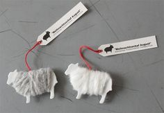 Sheep Gift Tags  via pen­nyver­tone on dewanda  Cre­ate a basic sheep sil­hou­ette using a clip art for the sten­cil. Cut out of thick card­stock in shades of linen, wheat, or cloudy grey and wrap with cor­re­spond­ing wool yarn or roving.