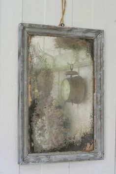 The foxing on this old mirror makes it a no-no in a practical sense, but instead turns it into a beautiful work of art.