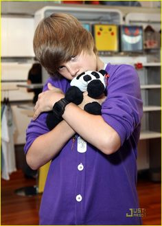 Two of my favorite things. Justin and Pandas! (: