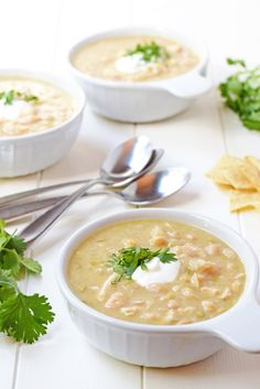 This Slow Cooker White Chicken Chili is the perfect fall dinner recipe! Creamy, hearty, healthy, and all you have to do is sit back and let the slow cooker do all the work!