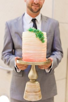 A white to pink ombre wedding cake