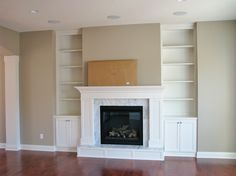 Entertainment storage surrounding the fireplace, adds height and drama! Made By: Lakeside Cabinets and Woodworking