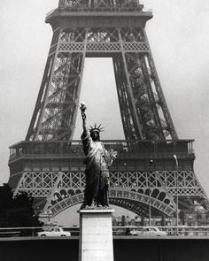 photo : Robert Doisneau - la Tour Eiffel et la statue de la Liberté. there's a (smaller) statue of Liberty in Paris (remember the big one was built in Paris and offered to US govt by France) Tour Eiffel, Robert Doisneau Photos, Henri Cartier Bresson, French Photographers, Vintage Paris, Paris Street, Oeuvre D'art, Belle Photo, Black And White Photography