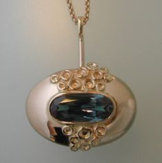 Marjut Viitanen, gold pendant with alexandrite. #finland | finlandjewelry.com