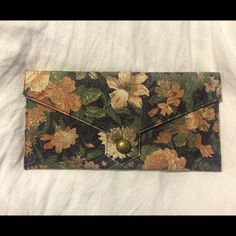 floral vinyl clutch URBAN OUTFITTERS floral vinyl clutch, pretty perfect condition. has strap for wrist! and pockets for your cards on the inside plus a zipper pocket on the inside. perfect to pair with a dress or some bell bottoms and wedges! Urban Outfitters Bags Clutches & Wristlets
