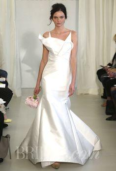 Brides.com: Angel Sanchez - Spring 2014. Style N10014, v-neck soft faille mermaid wedding dress with asymmetrical cascading ruffle, Angel Sanchez