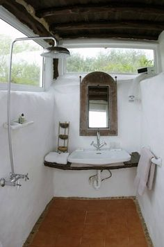 Inspiration from Bathrooms.com: Okay, so it's in Ibiza, so not desperately practical for the average UK bathroom - but embrace its spirit with rough plastered walls, terracotta tiles and 'found in a flea market' accessories.  #bathrooms #shower rooms #wet rooms #ensuite #vintage style #industrial style #loft living