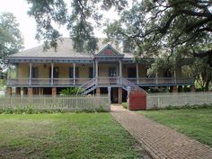 Laura Plantation House, Vacherie, Louisiana ~ The original house was completed in 1805 by Guillame Duparc, built in a U-shape with the customary detached kitchen; it has undergone many changes through the years. The Duparc family farmed over 12,000 acres of sugarcane, with a sugar mill about 1 mile from the main house.  The property changed hands in 1891, continuing as a working plantation into the 20th century. On the National Register of Historic Places, the plantation is open for tours.