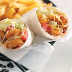 Southwest Chicken Wraps Recipe 16 pieces frozen popcorn chicken 2 tablespoons prepared ranch salad dressing 2 tablespoons picante sauce 2 flour tortillas (10 inches), warmed ¼ cup shredded lettuce ¼ cup chopped tomato ¼ cup shredded Mexican cheese blend