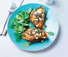 satisfying vegetarian recipe for baked sweet potatoes stuffed with feta cheese, pumpkin seeds & chilli then served with salad
