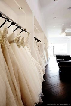diagonal floor. Recessed bridal racks with lighting inside.
