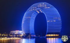 The #Sheraton Huzhou Hot Springs #Resort: this brilliant arc represents the perfect harmony between man and nature and colours the skyline of Huzhou, in #China, offering a stunning  view on a fabulous #landscape.  The 1,5 billion dollars worth structure is one of the most  exclusive hotels in the world!