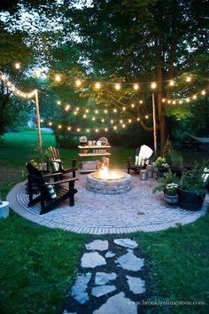 Poured concrete slab preferable (don't need the cobblestone look). Just like the idea of a fire pit on a paved area with poles to hold up string lights. We will need an outlet...