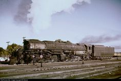 Big Boy 4011 has cut off its train from Cheyenne and soon will head for the Laramie roundhouse, where workers will ready it for another trip over Sherman Hill. In 1957, UP steam has two more seasons in front of it.