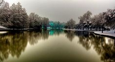 Exall Lake in Highland Park, Texas, was built in 1890 by damming Turtle Creek. It was originally larger and was a choice destination for family fun. Here it is photographed by Tom Landry as Dallas had some rare snowfall around the lake, offering a tranquil, picturesque scene.    Photo: Tom Landry Photography