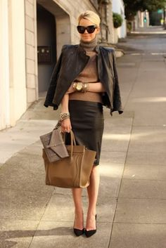 Smart & chic on the streets of the city. Love all of the gold bangles.