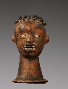 Ejagham Janus-headed mask from the Cross River region of Cameroon. Janus faced, skin covered cap masks were mounted on a basketry pedestal and were worn on top of the dancer's head. These masks were used by accomplished male dancers during funerals and initiations.