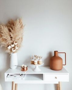 @curiouscountry posted to Instagram: Beautiful neutrals add texture to this minimalistic space. Pampas grass and bell cups are available now in store. #homedecor #decoration #livingroominspiration #livingroominso #diyhomedecor #decorating #decorideas #homestyle #decoratemyspace #naturaldecor #neutraldecor #pampas #pampasgrass #bellcups #minimalistic #driedflowers