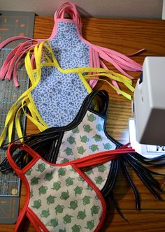 For years I had one of these tied around a bottle of dish soap.   -   Sew Tacey: Mini Apron Tutorial