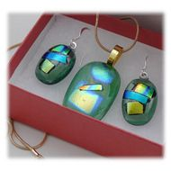 The dichroic glass cabochons for the pendant, matching earrings were handmade, by me with love. They are fused in my glass kiln to very high temperatures, 1500 degrees F and annealed for strength. They each comprise layers of carefully handcut glass,wi...