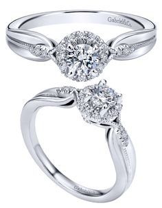 An intricate 14k White Gold Contemporary Halo Engagement Ring by Gabriel & Co. that is an unforgettable ring for the perfect woman! Have this unique engagement ring to show your love and passion for your significant other that you plan on spending the rest of your life with!