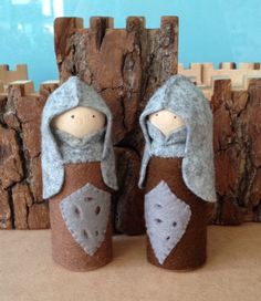 This listing is for 2 little knights.  They stand about 9cms tall (3 3/4 inches approx)  They are sturdily made with a wood peg doll base. (Please